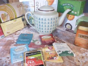 tea pot and packets of tea